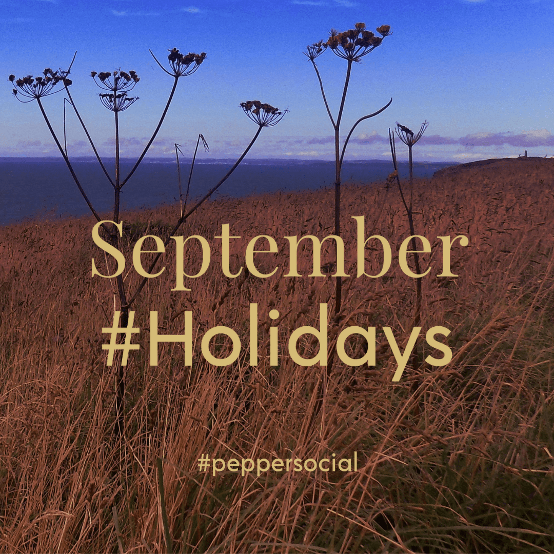 An autumnal fiels next to the sea, with the text overlay September #Holidays
